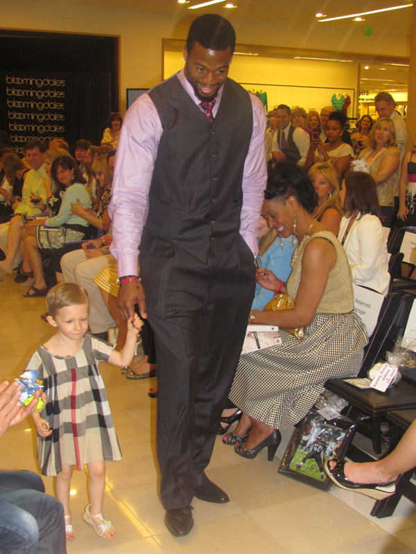 Rally Kid Ansley rockin the runway with Ray Edwards of the Atlanta Falcons
