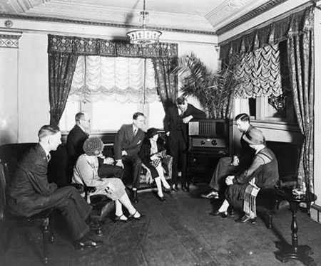 People gathered around to listen to the radio in the 1920s and 30s