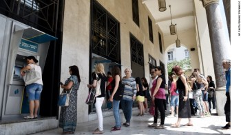 Greece Citizens Scramble for ATMs Before the Banks Close Photo Credit: CNN