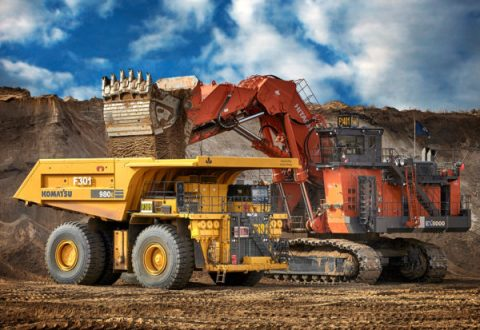 A hydraulic shovel places overburden in a haul truck at the Fort Hills site.  Courtesy of Suncor