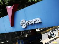 FILE PHOTO: A state oil company PDVSA's logo is seen at a gas station in Caracas, Venezuela May 17, 2019. REUTERS/Ivan Alvarado