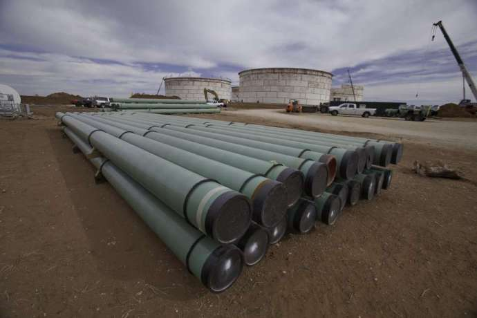 Oil holds losses on bearish headwinds from trade to stockpiles -oilandgas360