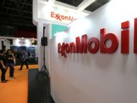 FILE PHOTO: A logo of the Exxon Mobil Corp is seen at the Rio Oil and Gas Expo and Conference in Rio de Janeiro, Brazil September 24, 2018. REUTERS/Sergio Moraes/File Photo