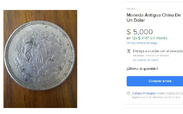 Esta es una de las caras de la moneda antigua china de un dólar