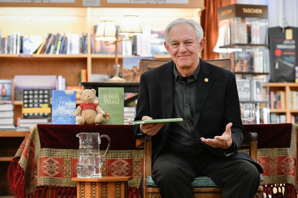 Dr. Joe Parent with a selection of his books.