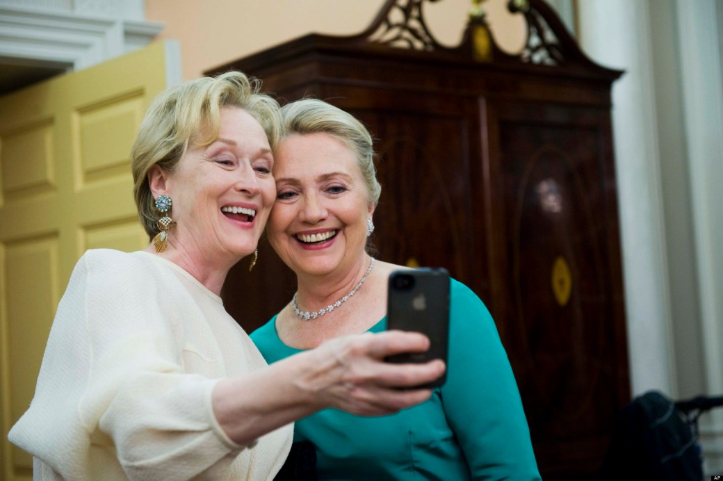 Actress Meryl Streep uses her iPhone to get a photo of her and Secretary of State Hillary Rodham Clinton