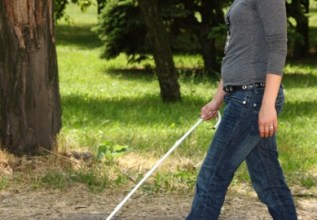 Blind Woman Using Cane