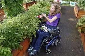 Woman in wheelchair gardening