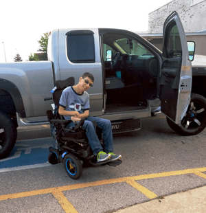 John B beside his dream truck