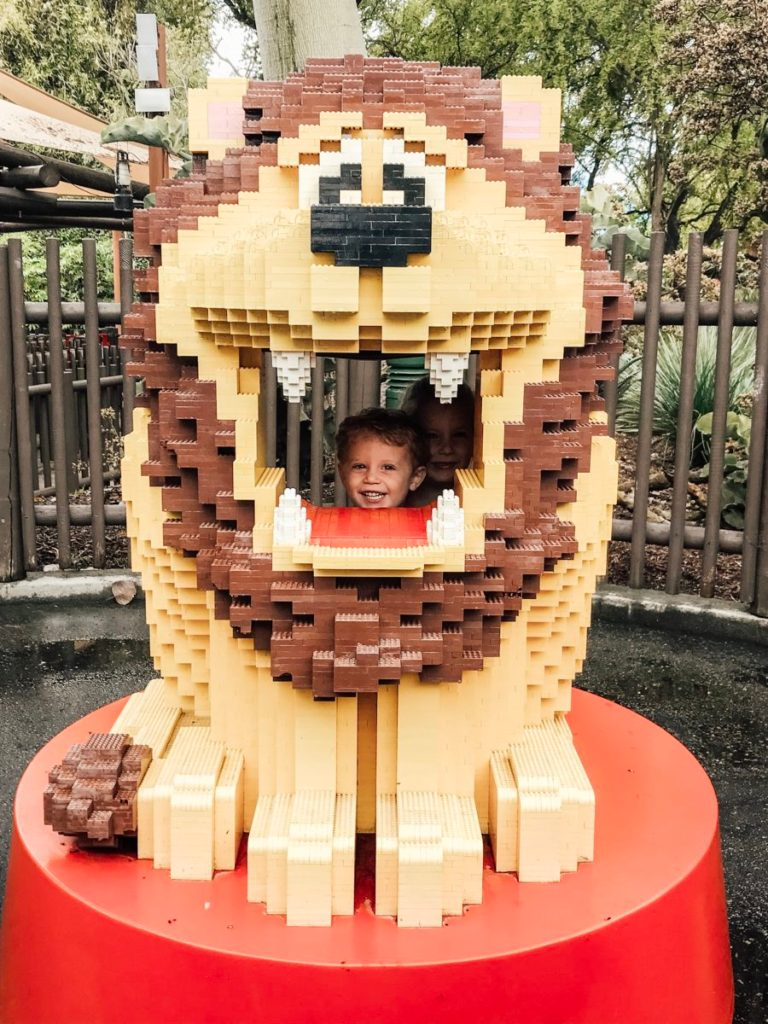 children in a lion made of LEGOs at Legoland California