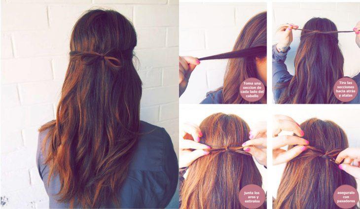 Menina penteando o cabelo com um coque na parte de trás da cabeça