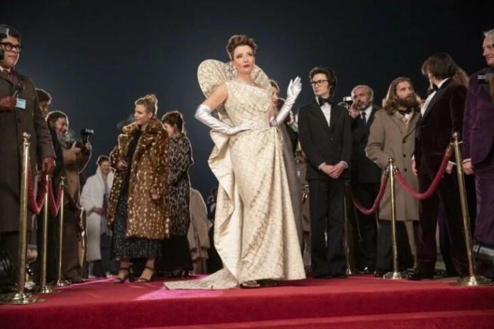Baroness of Cruella wearing a pearl-colored dress