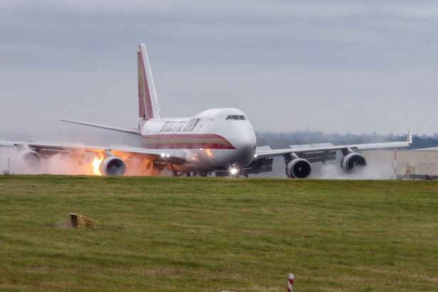Plane bursts into flames after making