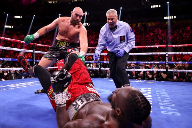 The moment Tyson Fury knocked out Deontay Wilder to retain WBC, Ring magazine and lineal heavyweight titles (videos)
