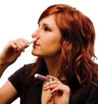 Woman Using Olbas Inhaler