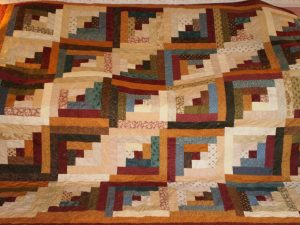 Log Cabin Quilt by Margy Quinn