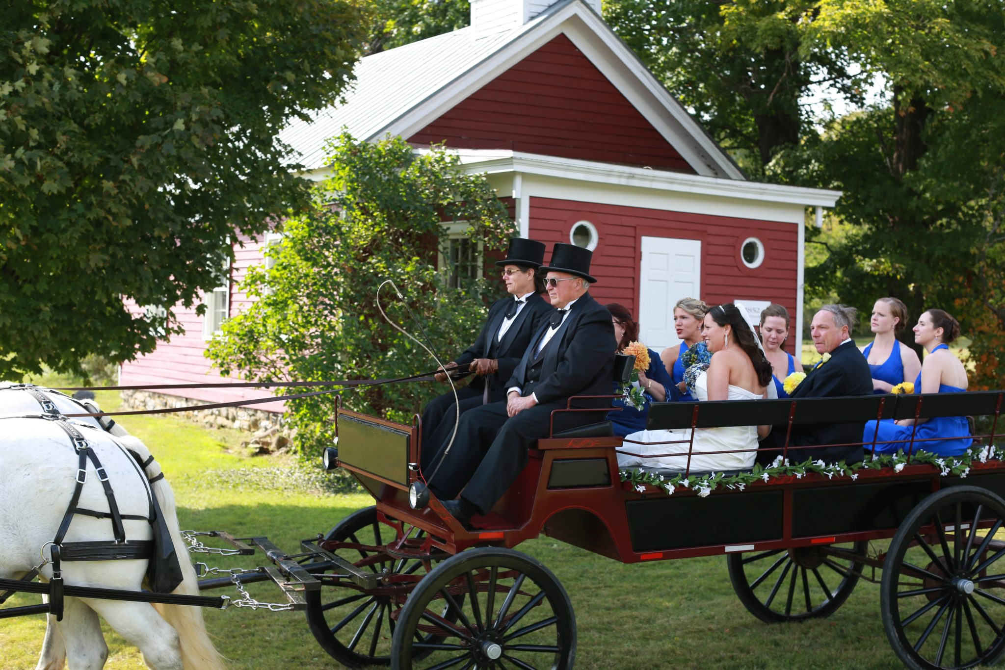 Passing the schoolhouse in horse-drawn carriage at OA