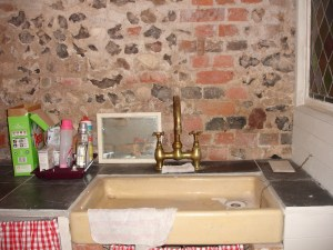 french sink with brick and flint wll