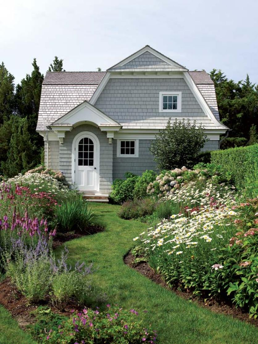 The exterior of the home looks like a storybook cottage.