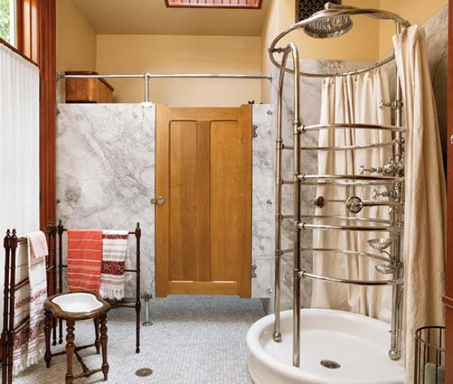 A Hex Tile Floor Swinging Door Set Into Marble Walls And Wood Wainscot