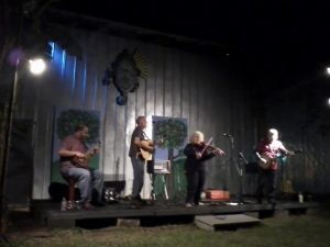 The Eclectic Acoustic Band, playing in the back yard of the Mickee Faust Club on a fine fall evening.