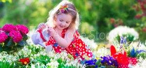 Little girl working in the garden   Old Metairie Garden Club