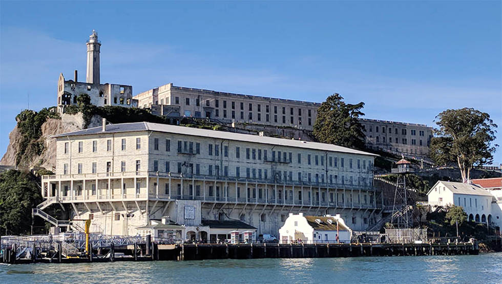 Structures dating from 1854 come into view as the ferry approaches the dock at Alcatraz Island.