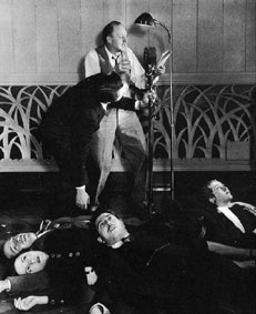 "The actor at the microphone is Sidney Ellstrom, but the ""corpse"" on top of the pile of bodies appears to be Harold Peary, who would later star as The Great Gildersleeve."