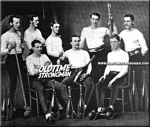 The Princeton Gymnastic Team, circa 1874, poses with large Indian Clubs and Dumbbells
