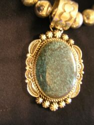 This piece was listed as an unsigned Tommy Singer necklace.