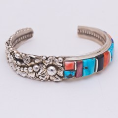 Beautiful Navajo bracelet featuring turquoise, shell and jet accented with leaf work