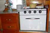 Early 1954 Shasta 1400 Travel Trailer with original gas stove and birch kitchen cabinets