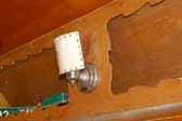 Original 120v light fixture and stitched lamp shade in a vintage 1954 Shasta 1400 Travel Trailer