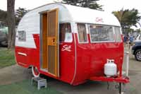 Photo shows a restored 1956 Shasta 1400 trailer with no wings on the side
