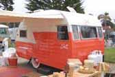 Beautifully restored Vintage Shasta 1400 travel trailer in pastel orange