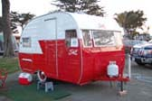 Old 1956 Shasta trailer nicely restored in 2 tone red and white paint scheme