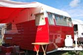 Great restoration of a classic 1957 Shasta trailer with red and white paint