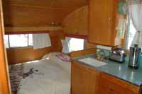 Interior view of a vintage 1961 Shasta trailer showing the kitchen countertop and original sink, which may include the manufacture date