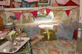 Photo of stylish decorations and accessories in 1969 Shasta Starflyte Trailer bedroom area