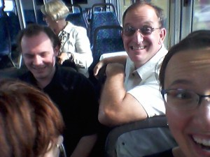 Happy bridge tourists on a Metro Transit bus