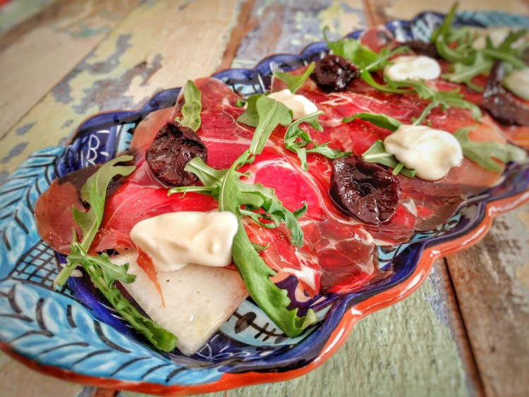 Cured ham with melon