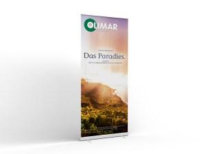 OLIMAR-Reisebüropartner werden mit dekorativen Kampagnen-Bannern ausgestattet. Achten Sie bei Ihrem nächsten Reisebüro-Besuch darauf.