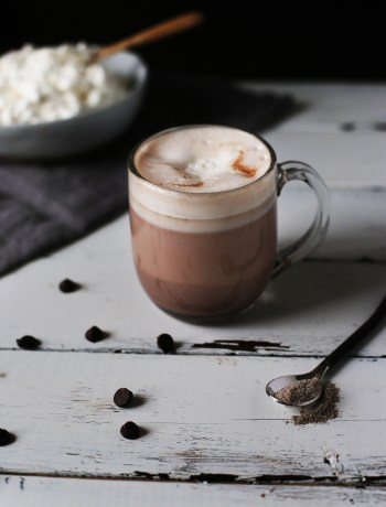 Cardamom and Honey Hot Chocolate, perfect for raining days and reading a book. Light herbal flavors and a fluffy honey whipped topping.