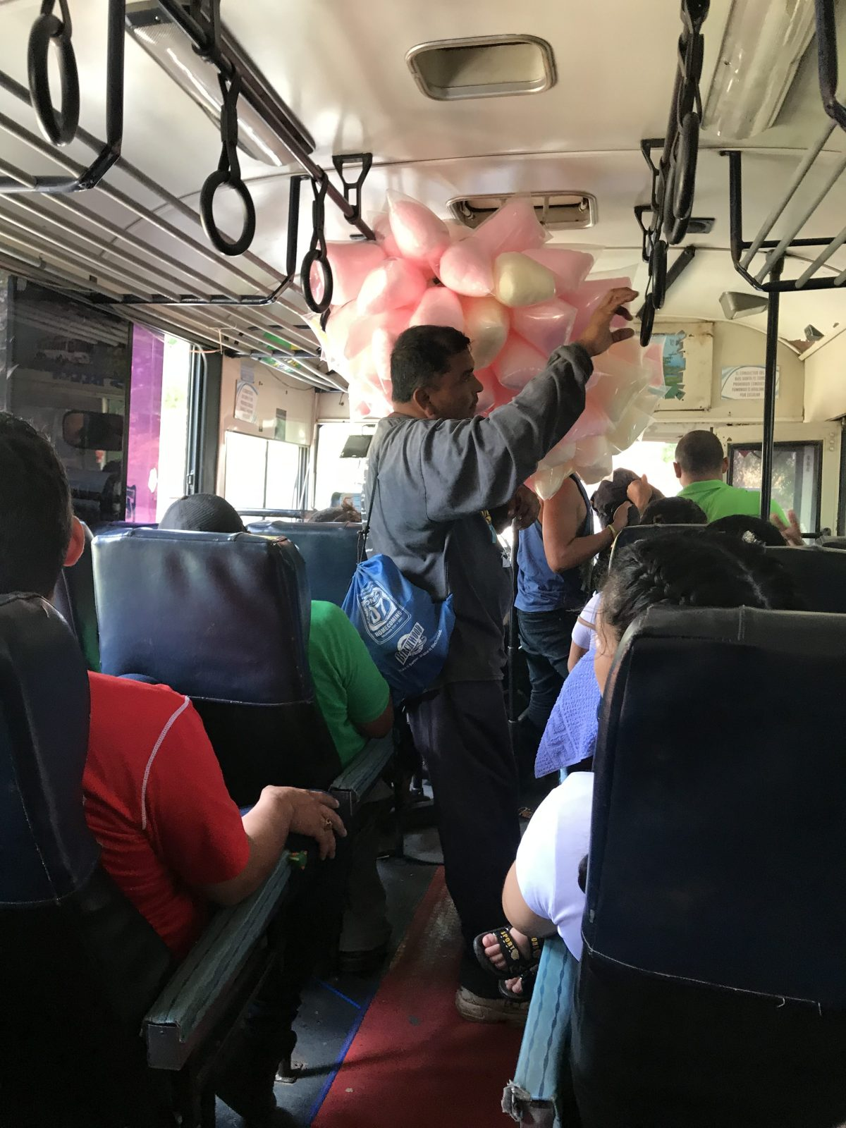 Cotton candy seller on the bus from San Jorge to Rivas