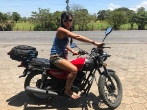Olla rides a motorcyle in Nicaragua