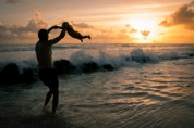 Father and Daughter at the Sea at Sunset