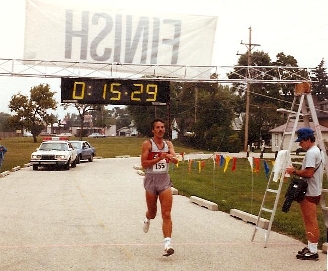 Fr. Chuck Schramm, an avid runner, finishes the race.