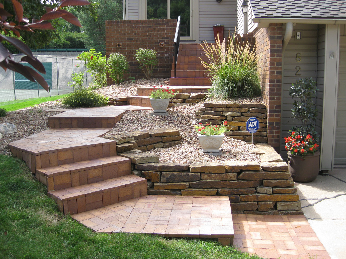 Photo Gallery of Patios - Omaha Landscape Design on Backyard Patio Steps  id=22385