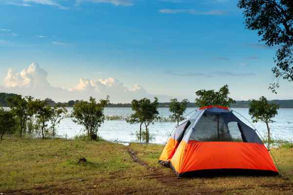 camping dome tent near a body of water
