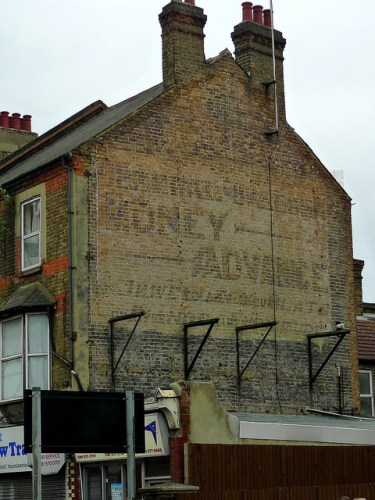 "Ghost sign located in Hounslow, London. Photo from Flickr user ""Ewan Munro"" - Creative Commons"